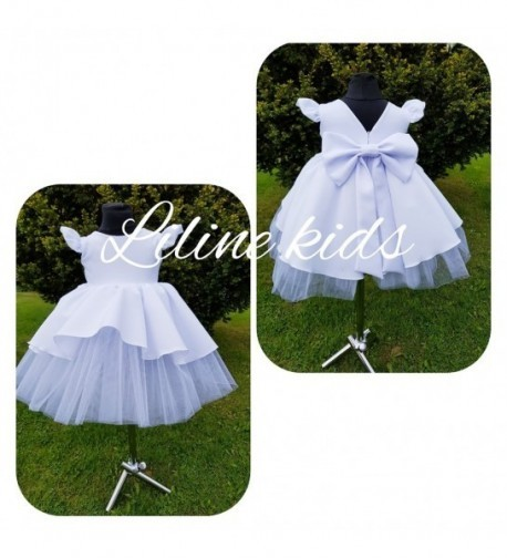 Pūsta suknelė su dideliu kaspinu nugaroje